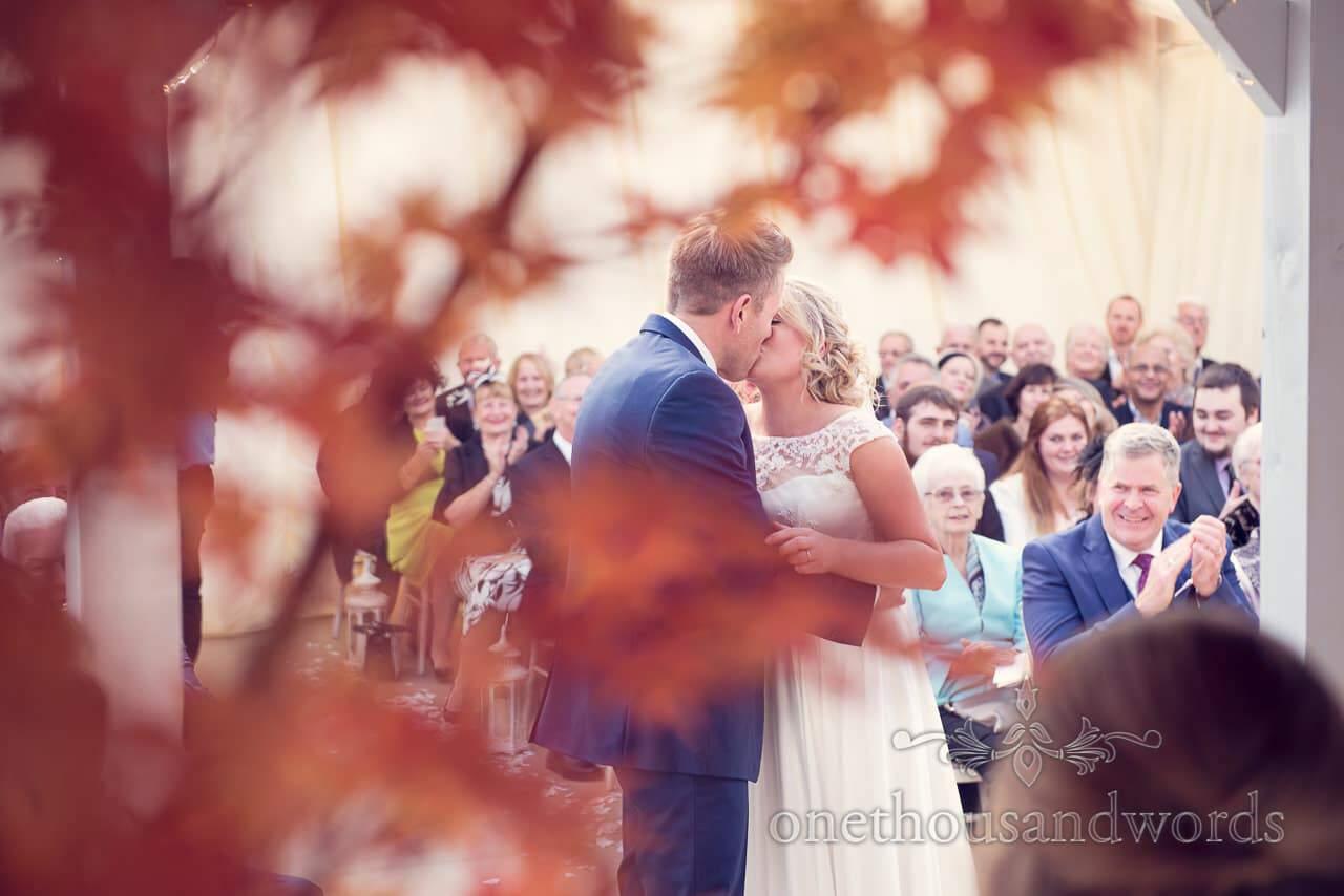 Couple kiss at Holme for Gardens Dorset wedding