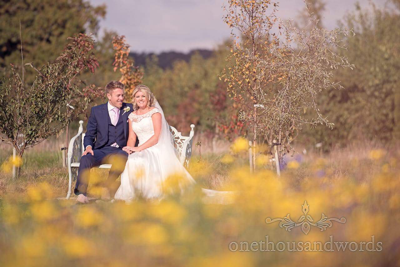 Couple on bench at Holme for Gardens Dorset wedding