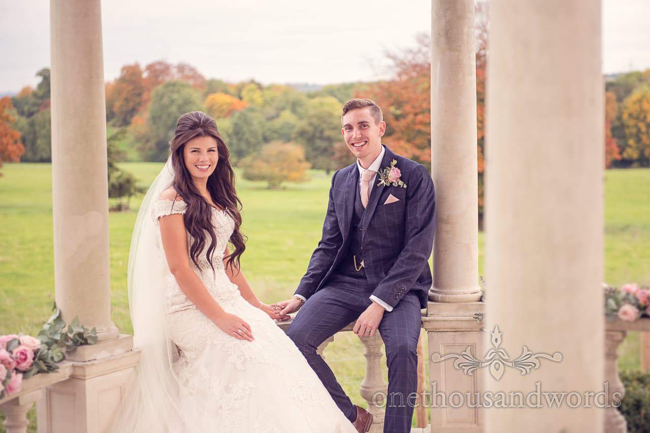 Couple seated in Pagoda at Froyle Park wedding photographs