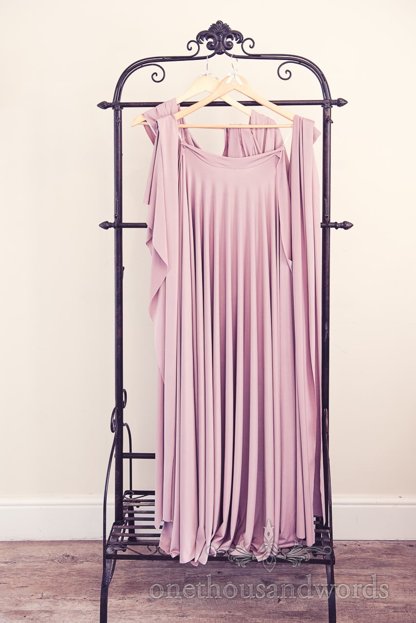 Dustry pink greco roman bridesmaids dresses hanging on Froyle Park wedding morning