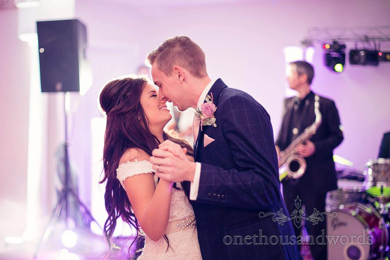 Embrace during first dance at Froyle Park wedding photographs