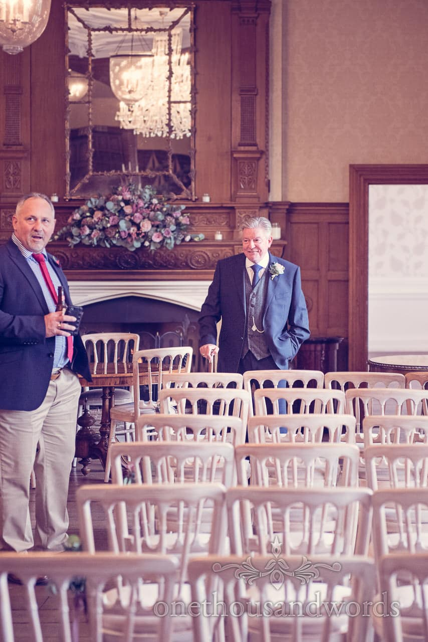 Father of bride in blue wedding suit in wedding ceremony room at Froyle Park