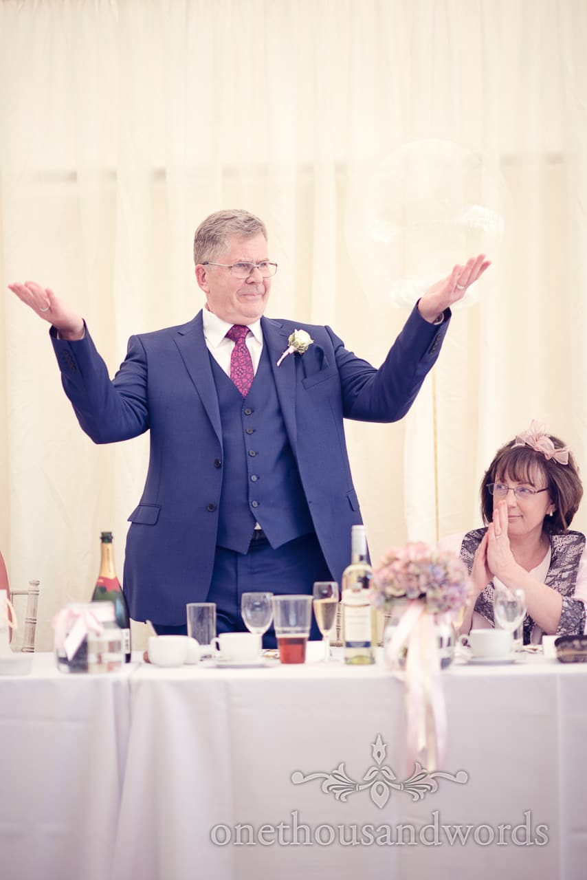 Father of the bride encourages guests Holme for Gardens Dorset wedding