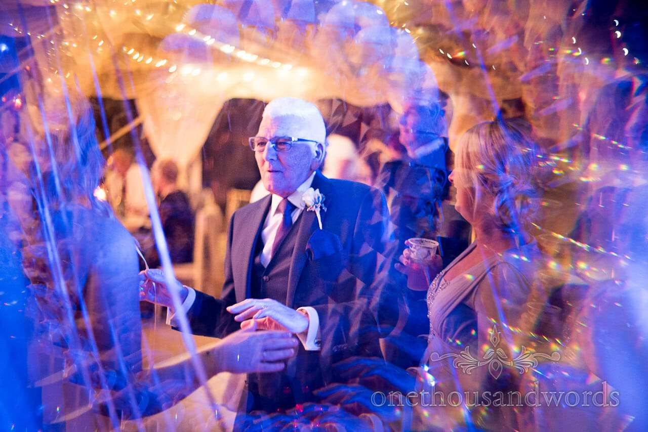 Father of the groom dances at Holme for Gardens Dorset wedding