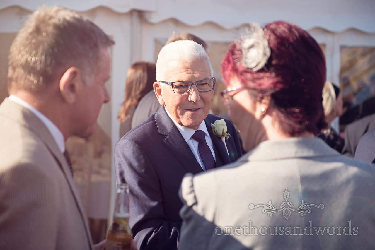 Father of the groom during reception at Holme for Gardens Dorset wedding