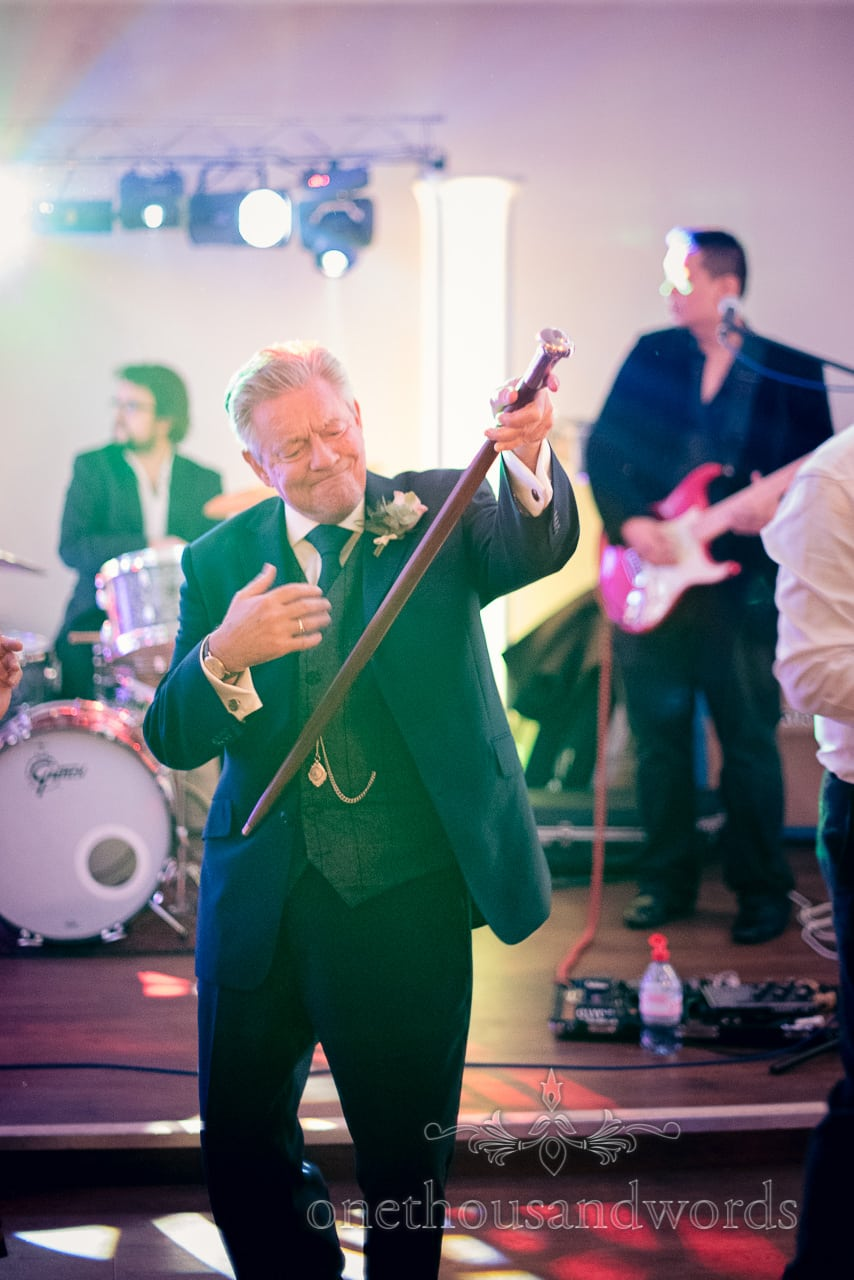 Father of the groom on dance floor at Froyle Park wedding photographs