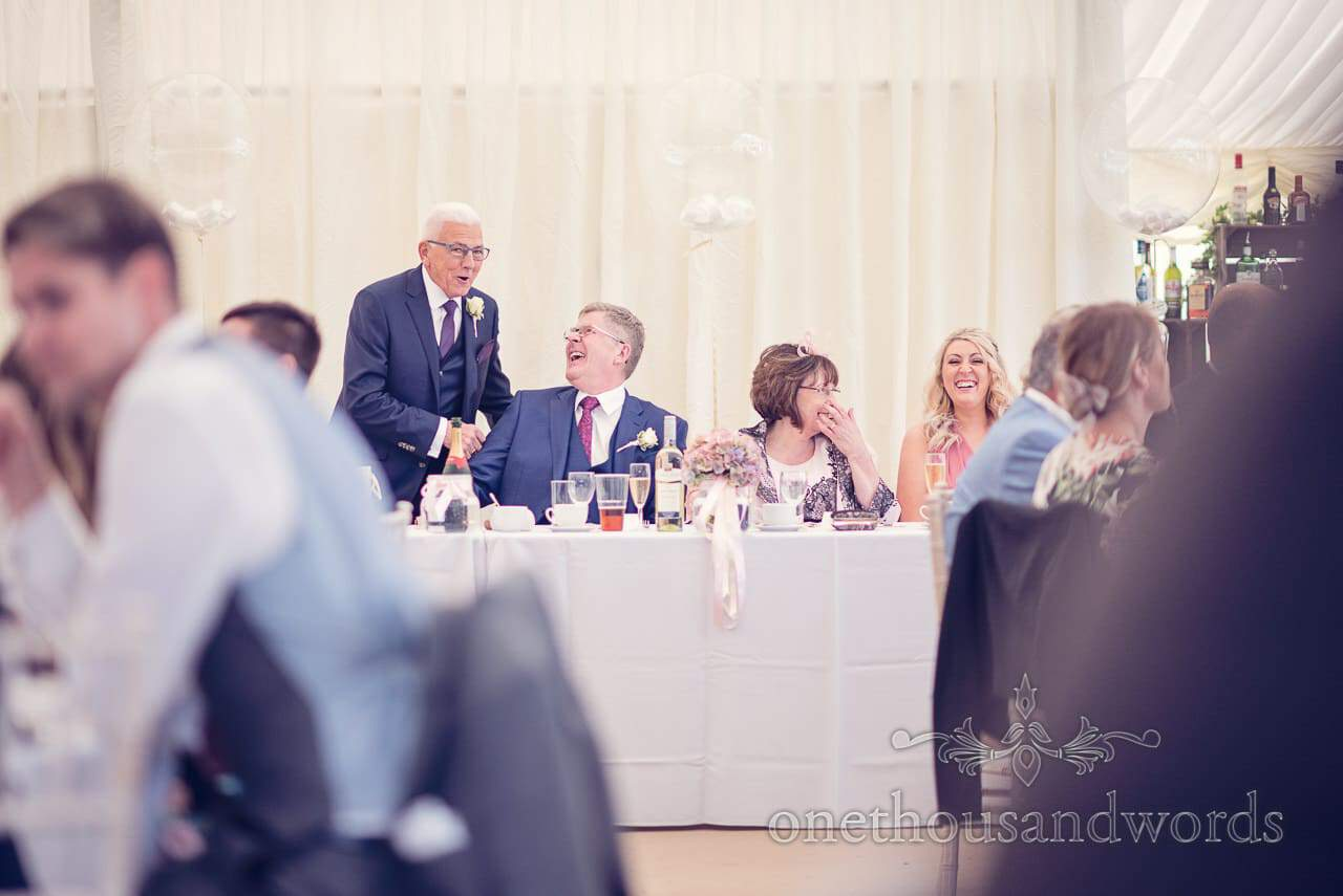 Fathers share a joke at Holme for Gardens Dorset wedding