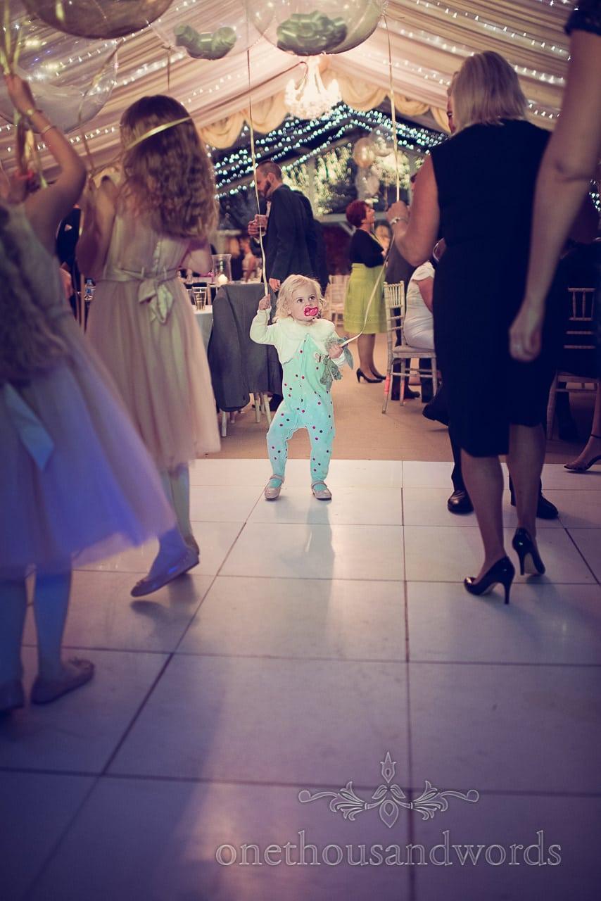 Flower girl in Pajamas dances at Holme for gardens Dorset wedding