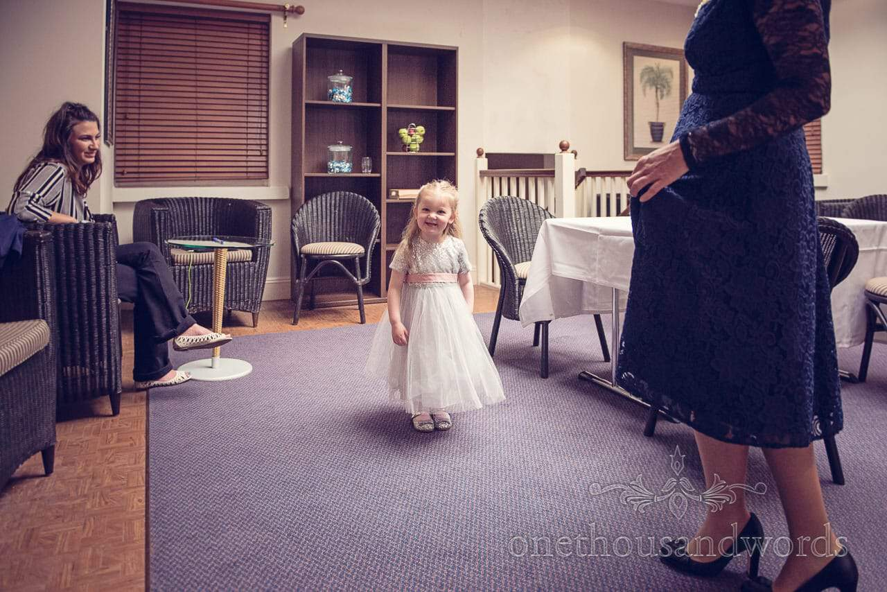 Flower girl in princess flower girl dress on wedding morning at Northcote House