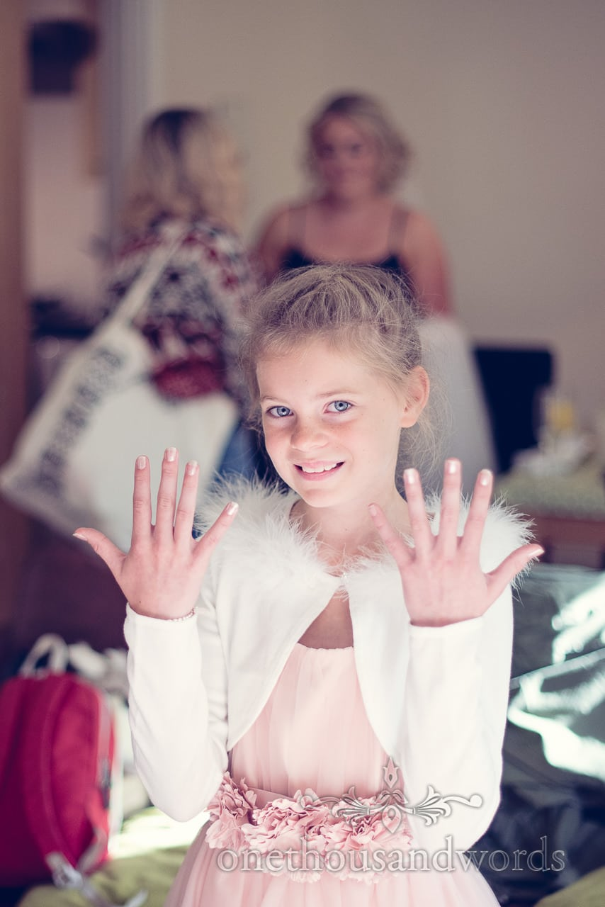 Flower girl shows off her nails before Holme for Gardens wedding