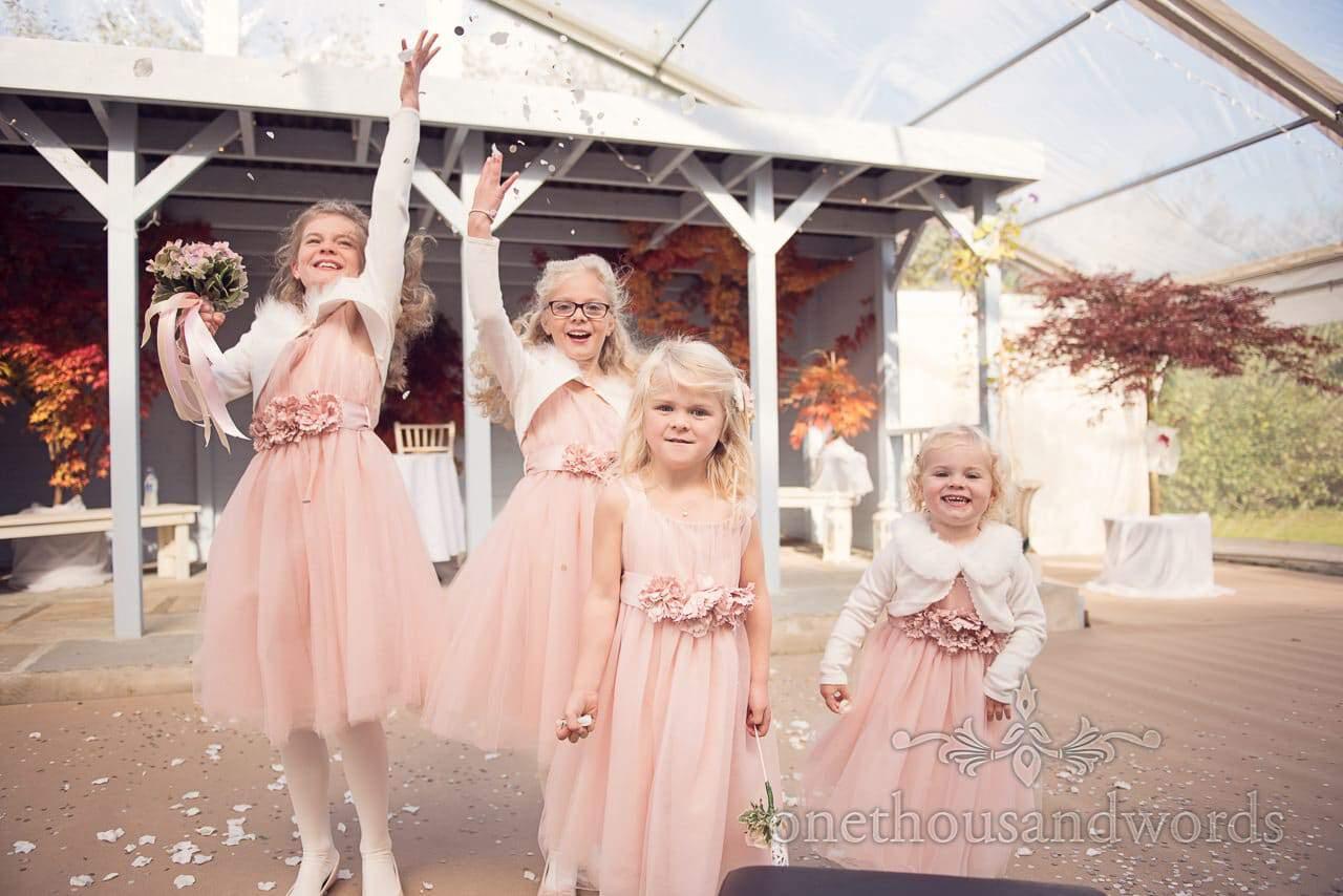 Flower girls throw confetti at Holme for Gardens Dorset wedding