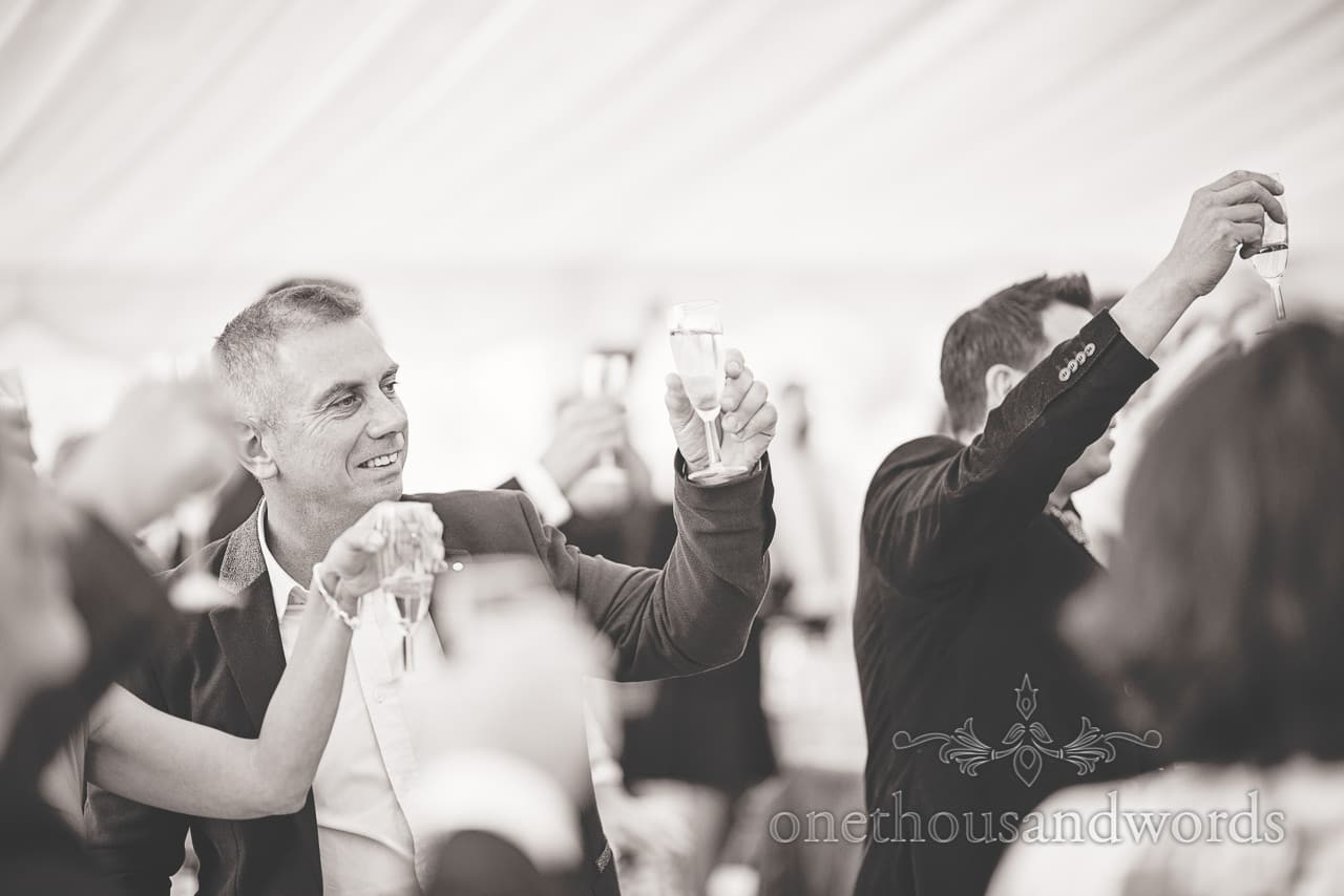 Glasses are charged at Holme for Gardens Dorset wedding