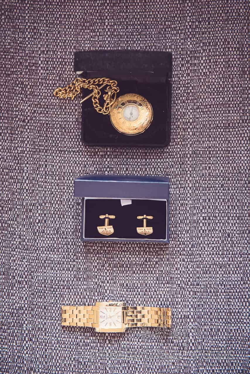 Gold wrist watch, pocket watch and Royal Marines Cufflinks for grooms wedding preperations