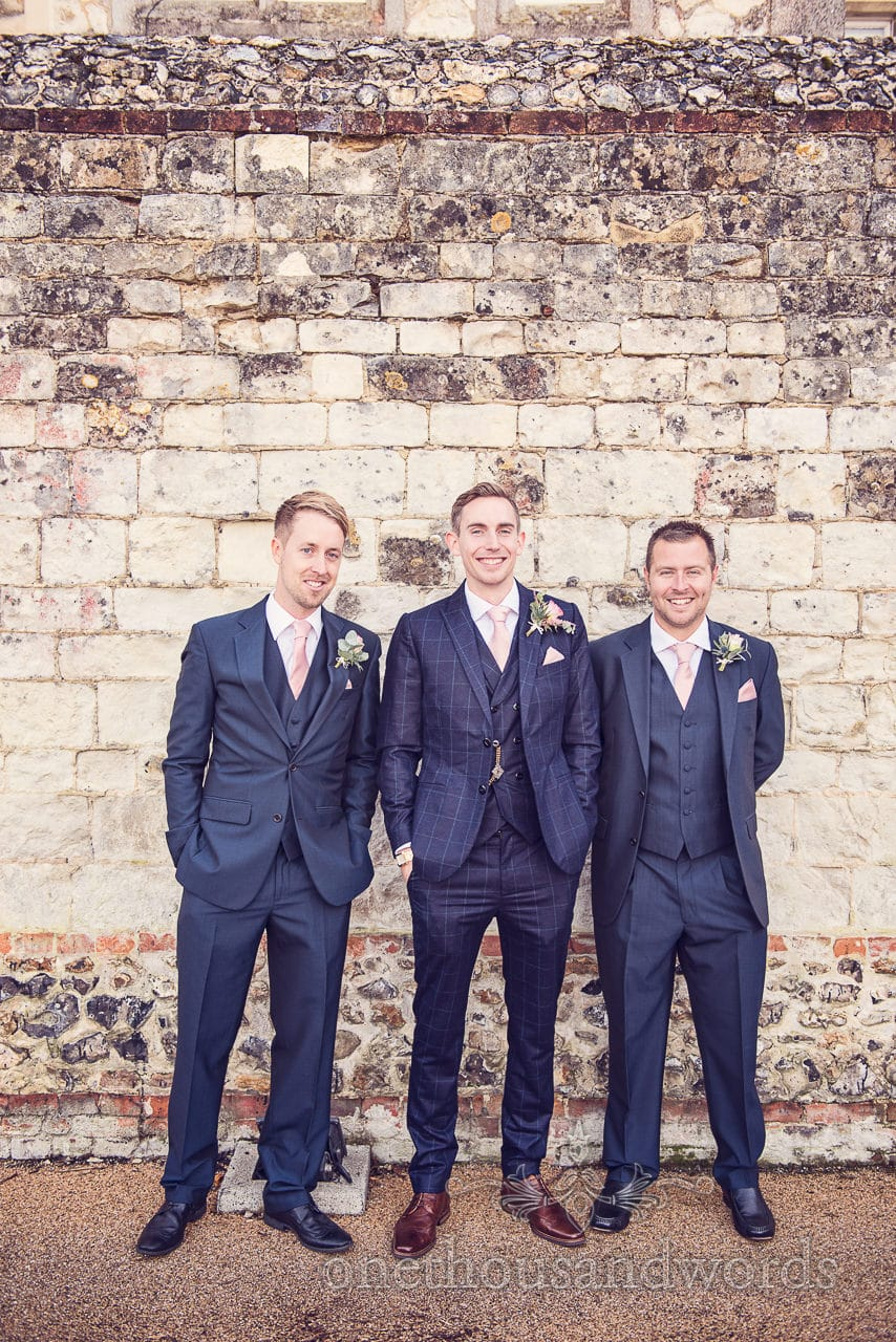 Groom and groomsmen in blue wedding suits at Froyle Park wedding photographs