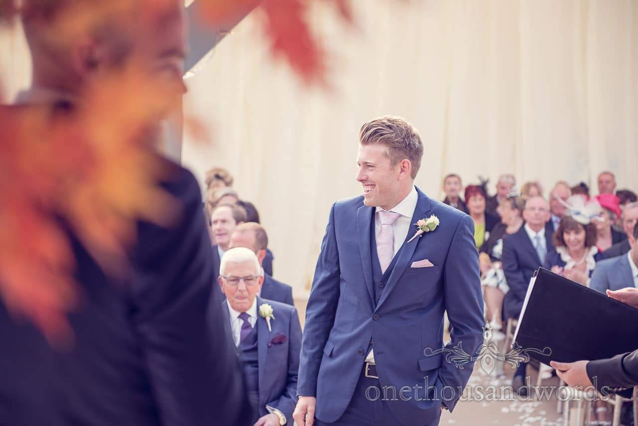 Groom awaits his bride at Holme for Gardens Dorset wedding