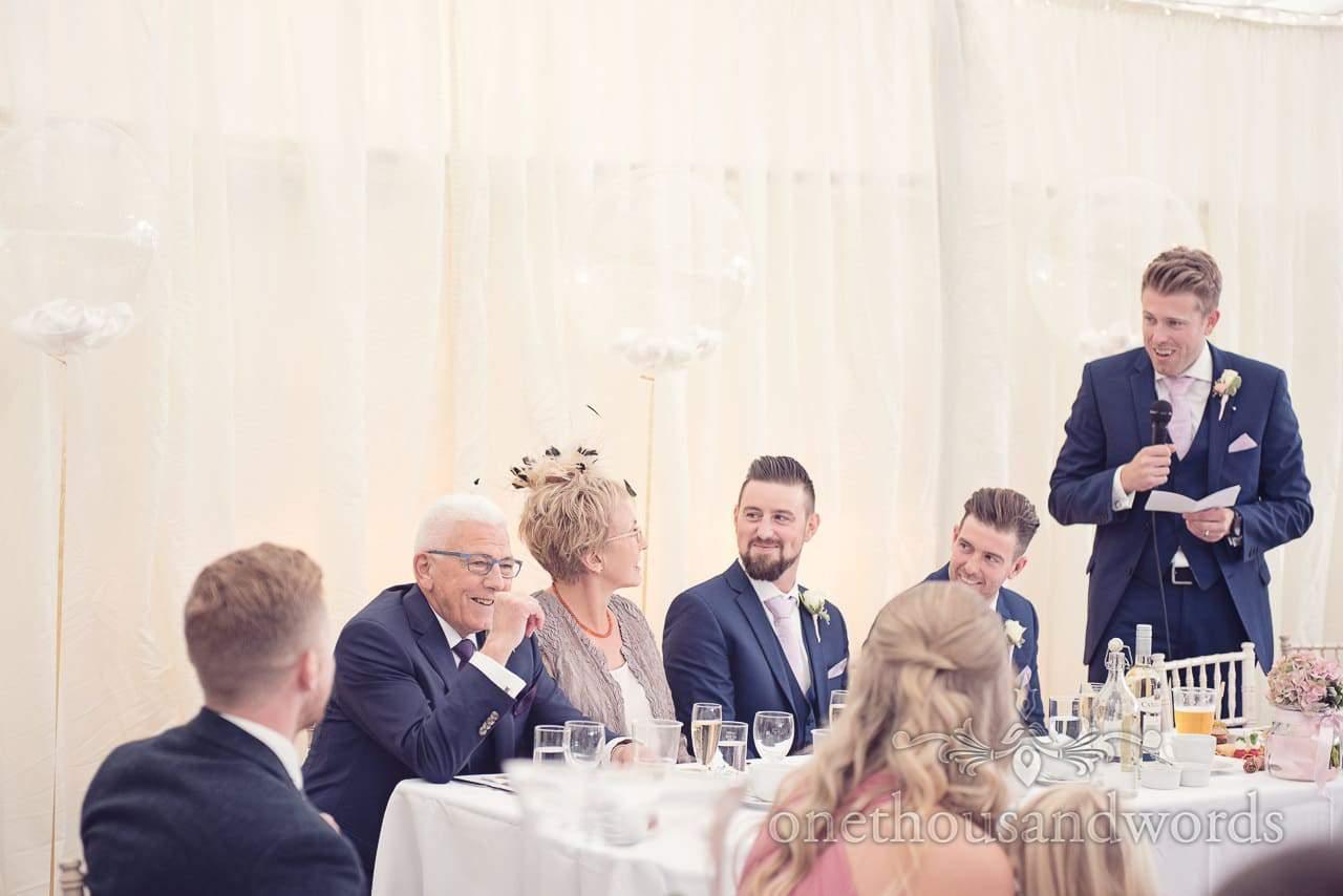 Groom delivers speech at Holme for Gardens Dorset wedding
