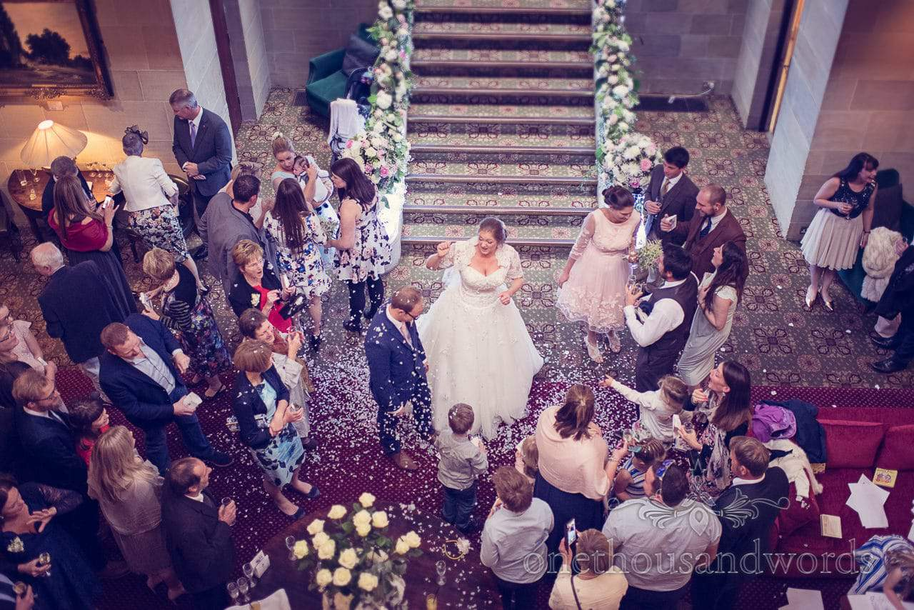 Groom in showered in wedding confetti at Northcote House wedding