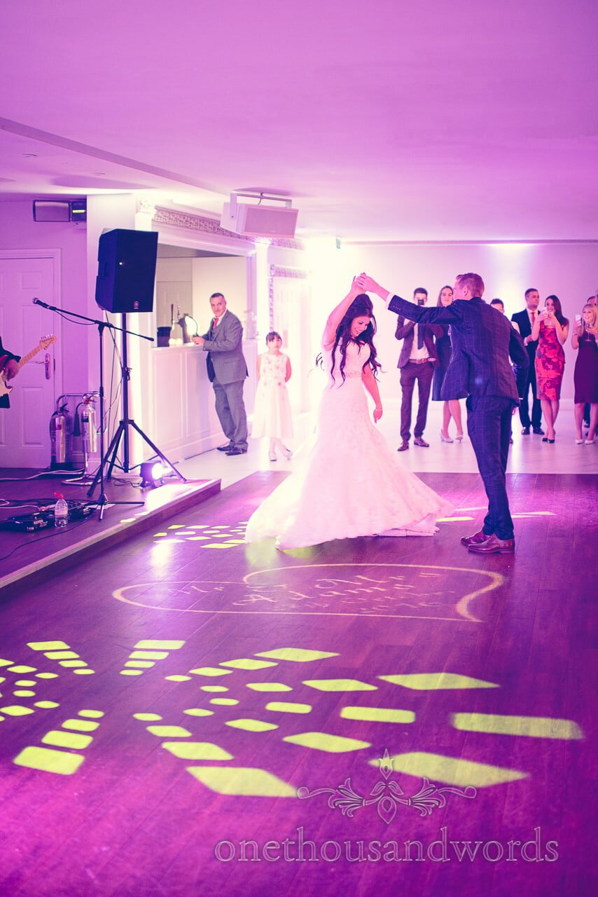Groom spins the bride during first dance at Froyle Park wedding photographs