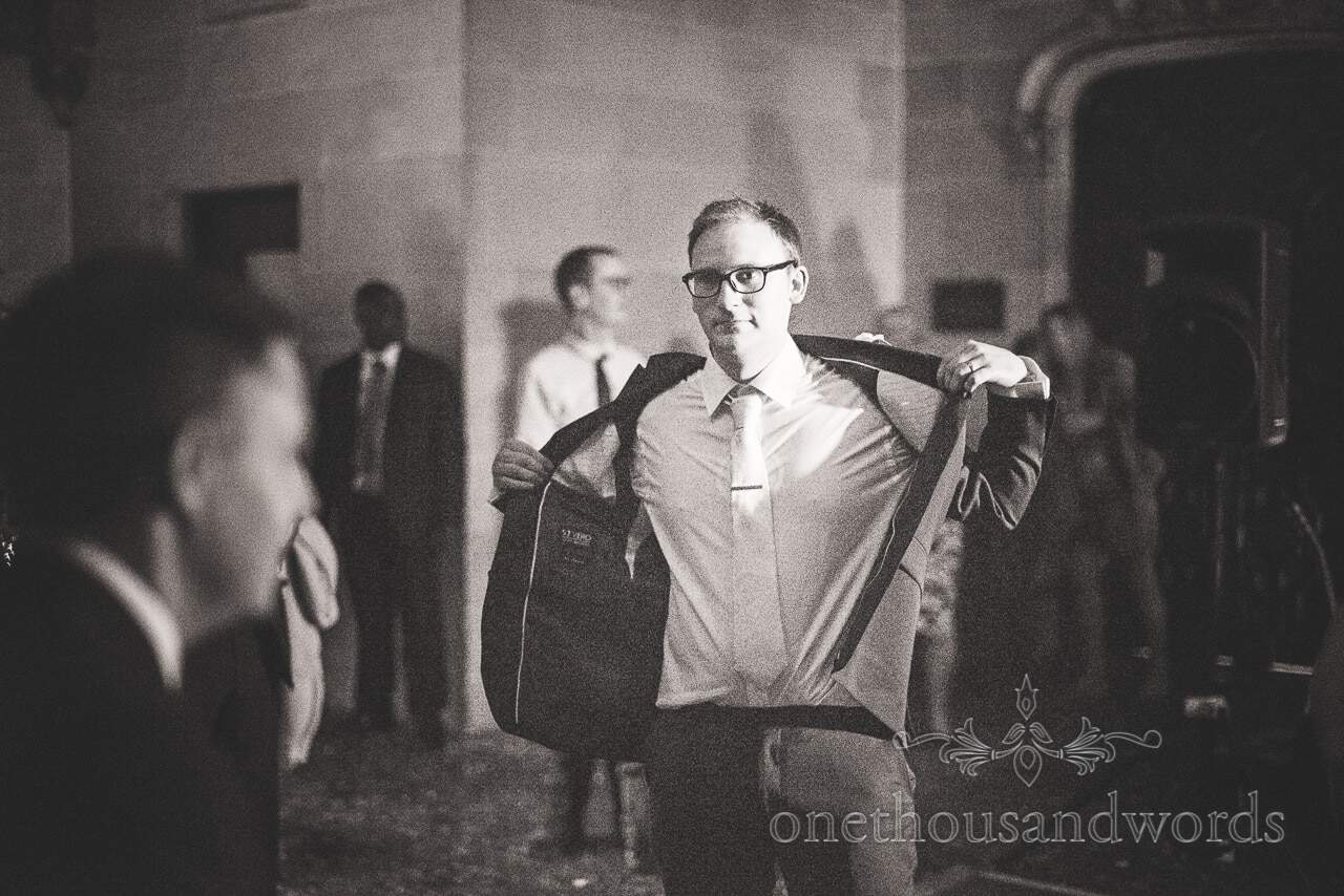 Groom takes of suit jacket looking cool during first dance at Northcote House wedding