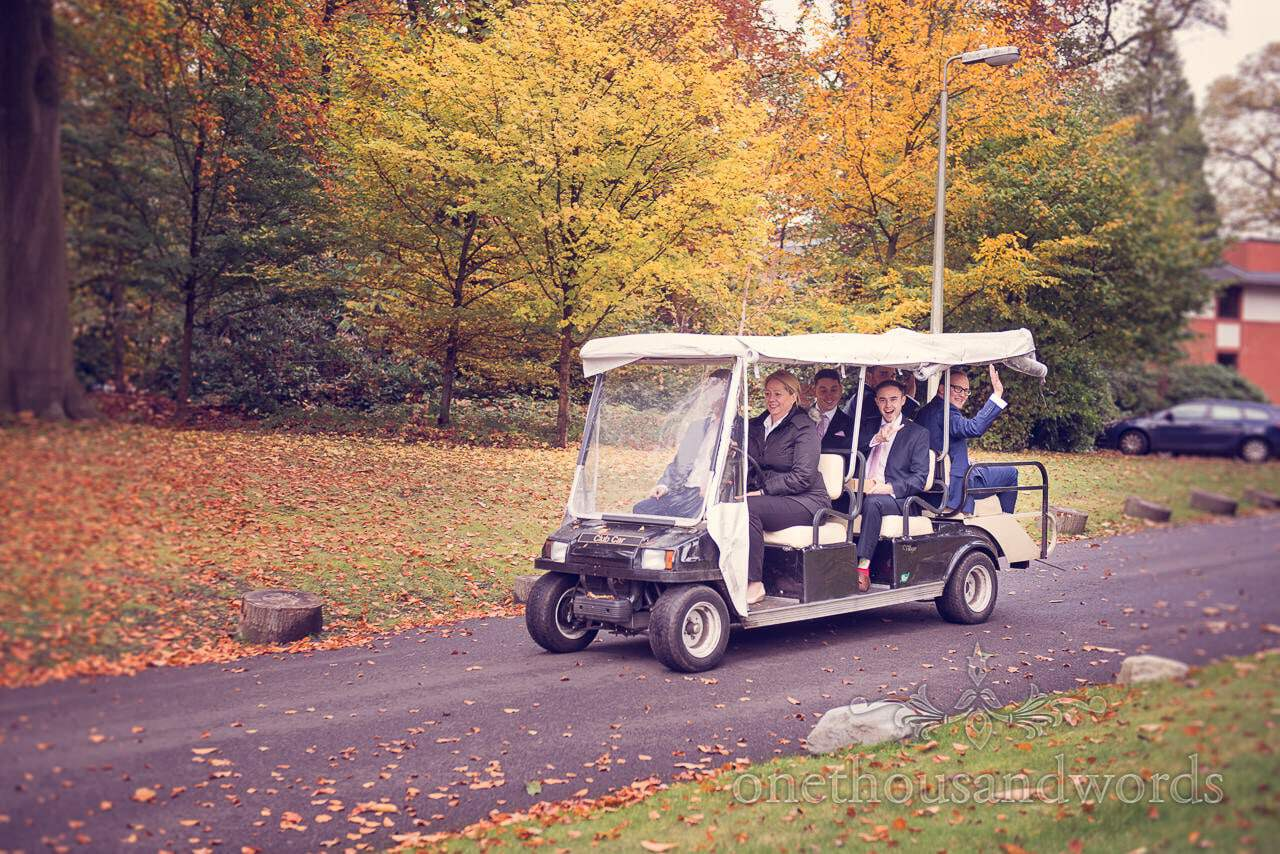 Groomsmen in golf cart with autumn leaves at Northcote House wedding