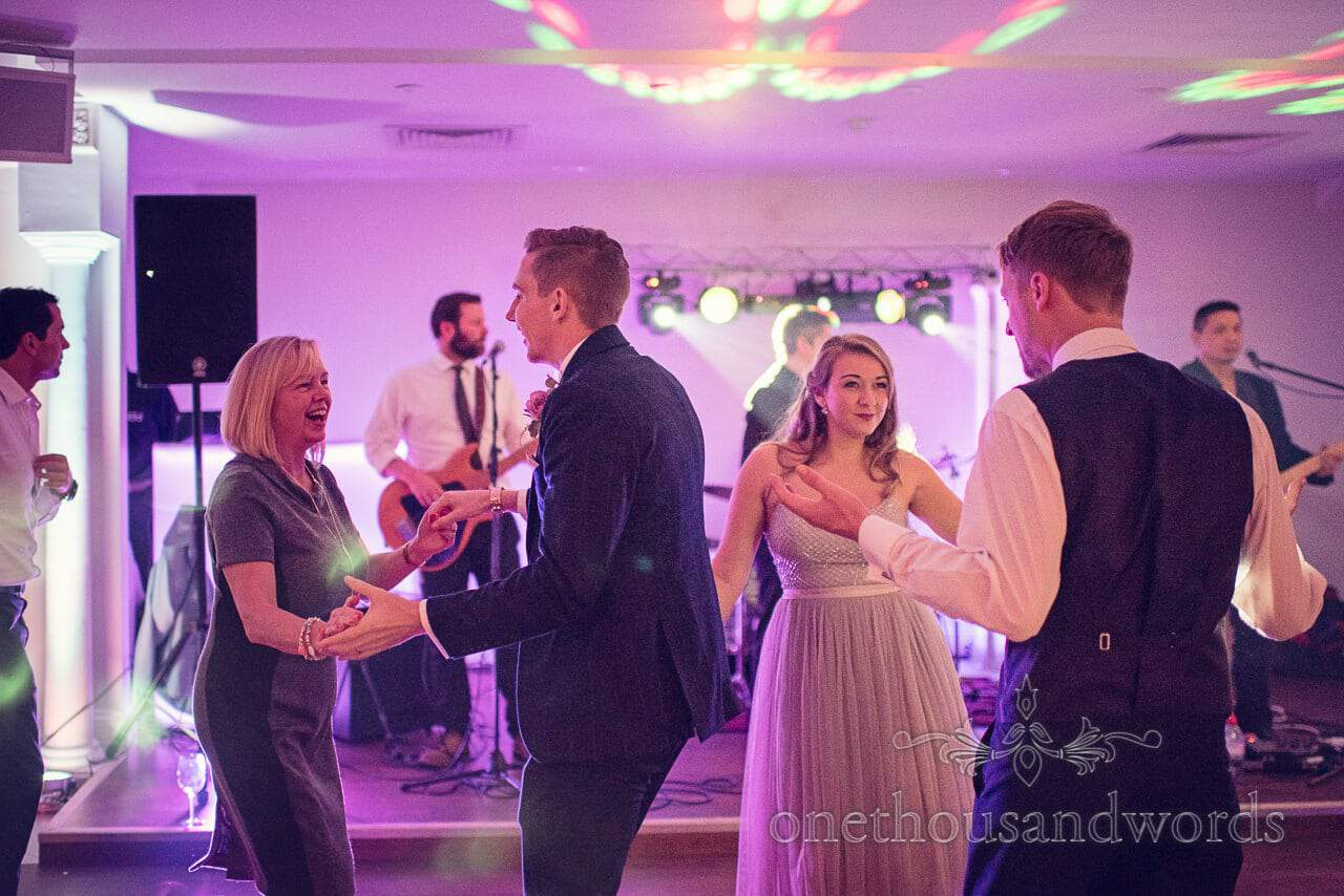 Grooom and guests dance at Froyle Park wedding photographs