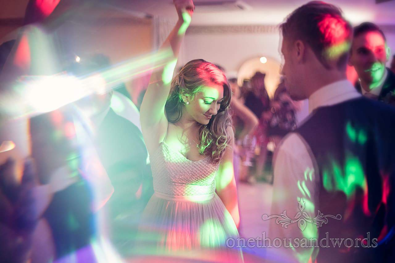 Guest dances at Froyle Park wedding photographs