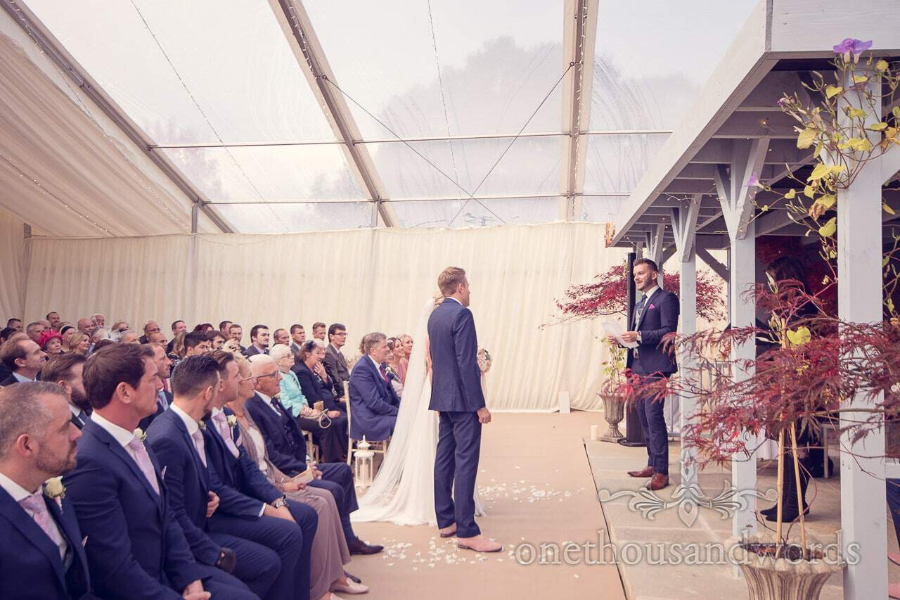 Guest delivers reading at Holme for Gardens Dorset wedding