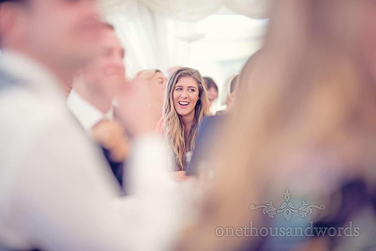 Guest reaction during speech at Holme for Gardens Dorset wedding