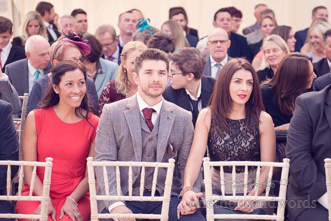 Guests await brides arrival at Holme for Gardens Dorset wedding