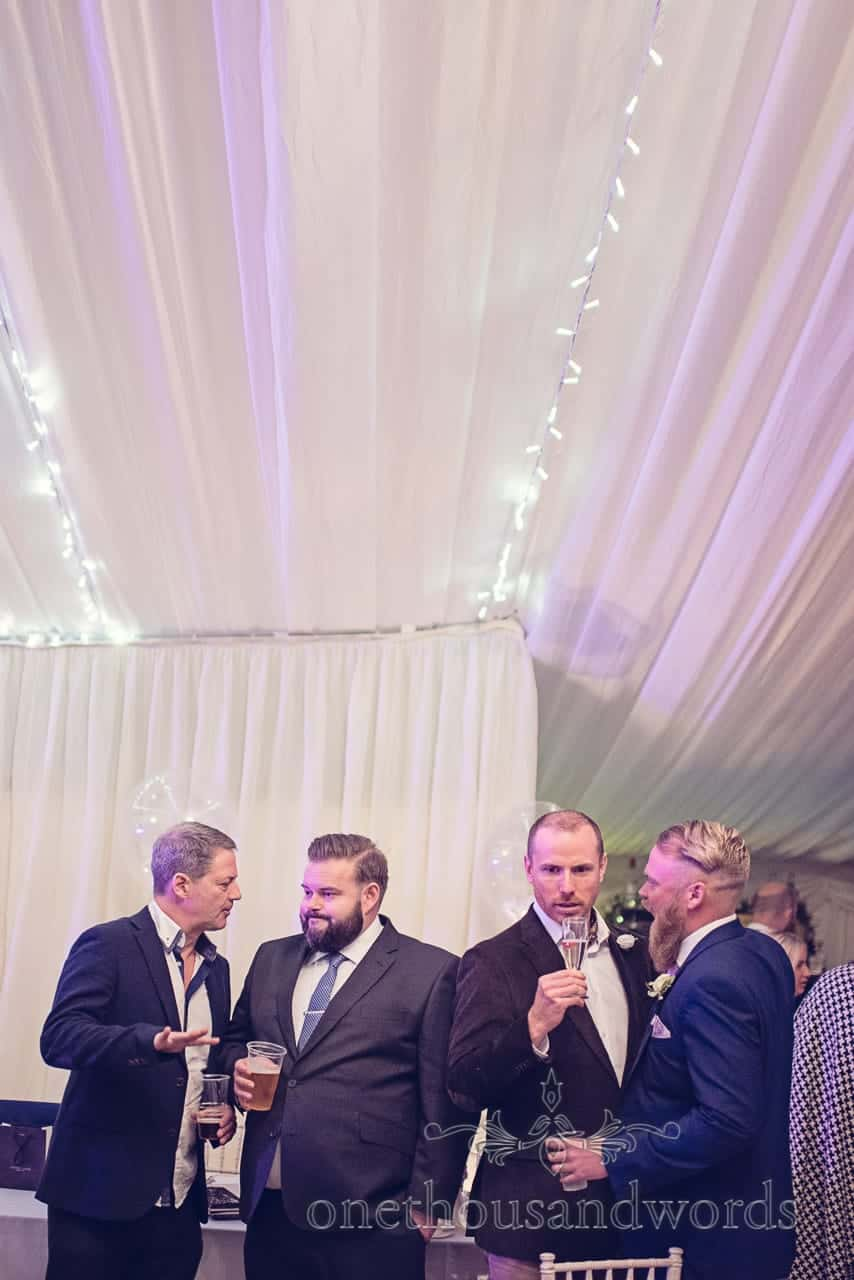 Guests drink and discuss at Holme for Gardens Dorset wedding
