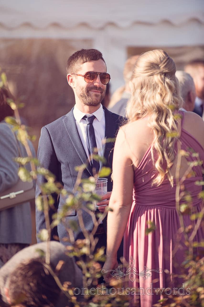 Guests enjoy drinks reception at Holme for Gardens Dorset wedding