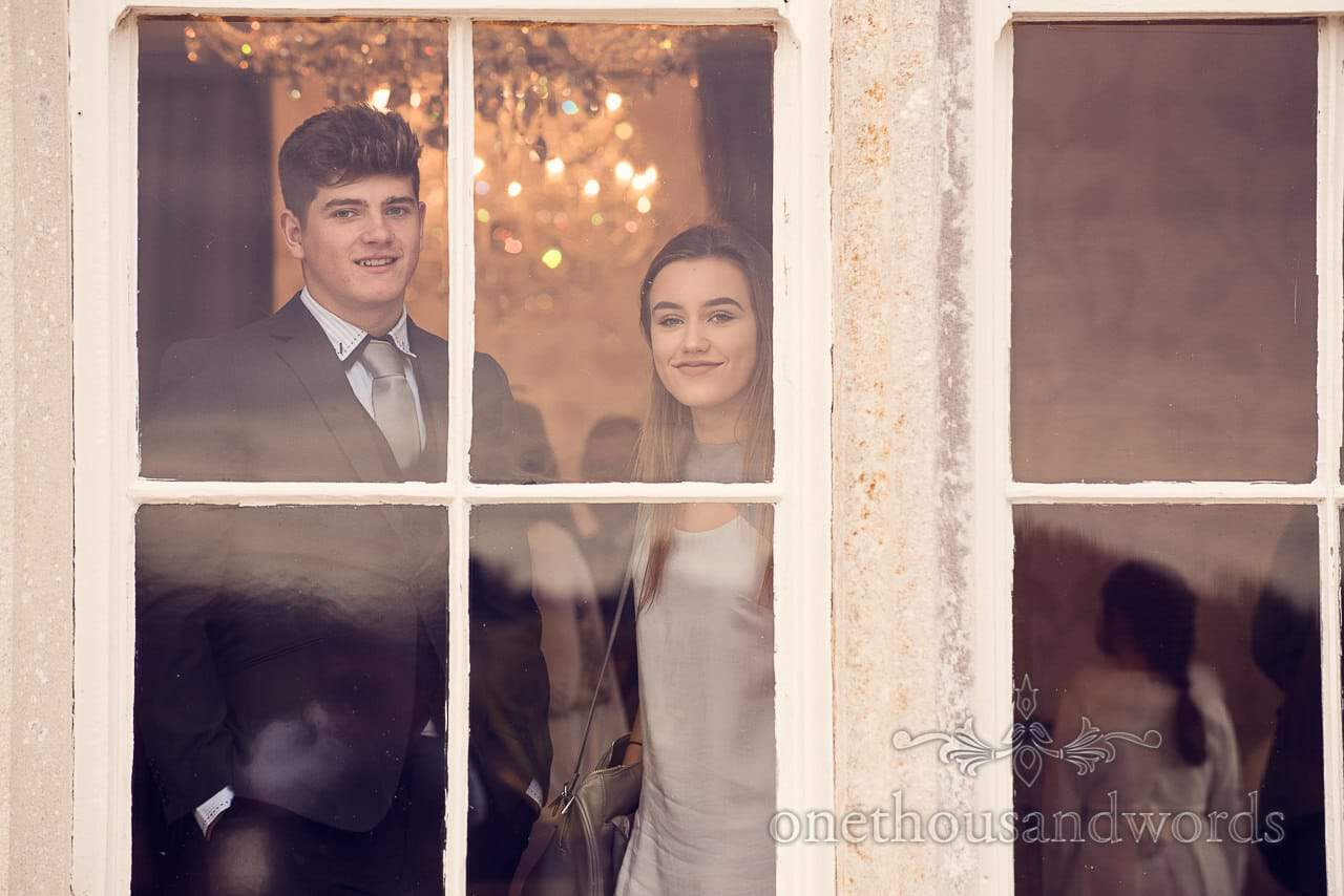Guests through the window at Froyle Park wedding photographs