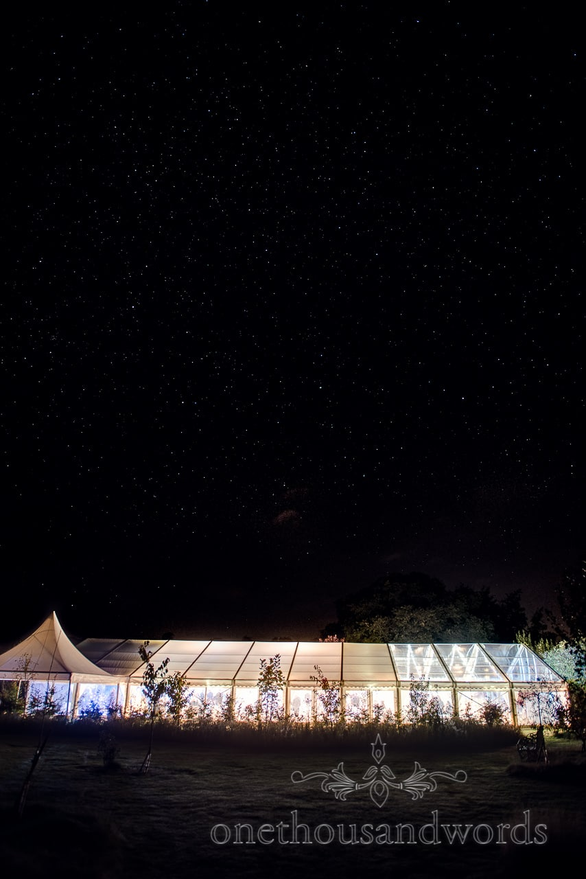 Marquee lit up under the stars at Holme for Gardens Dorset wedding