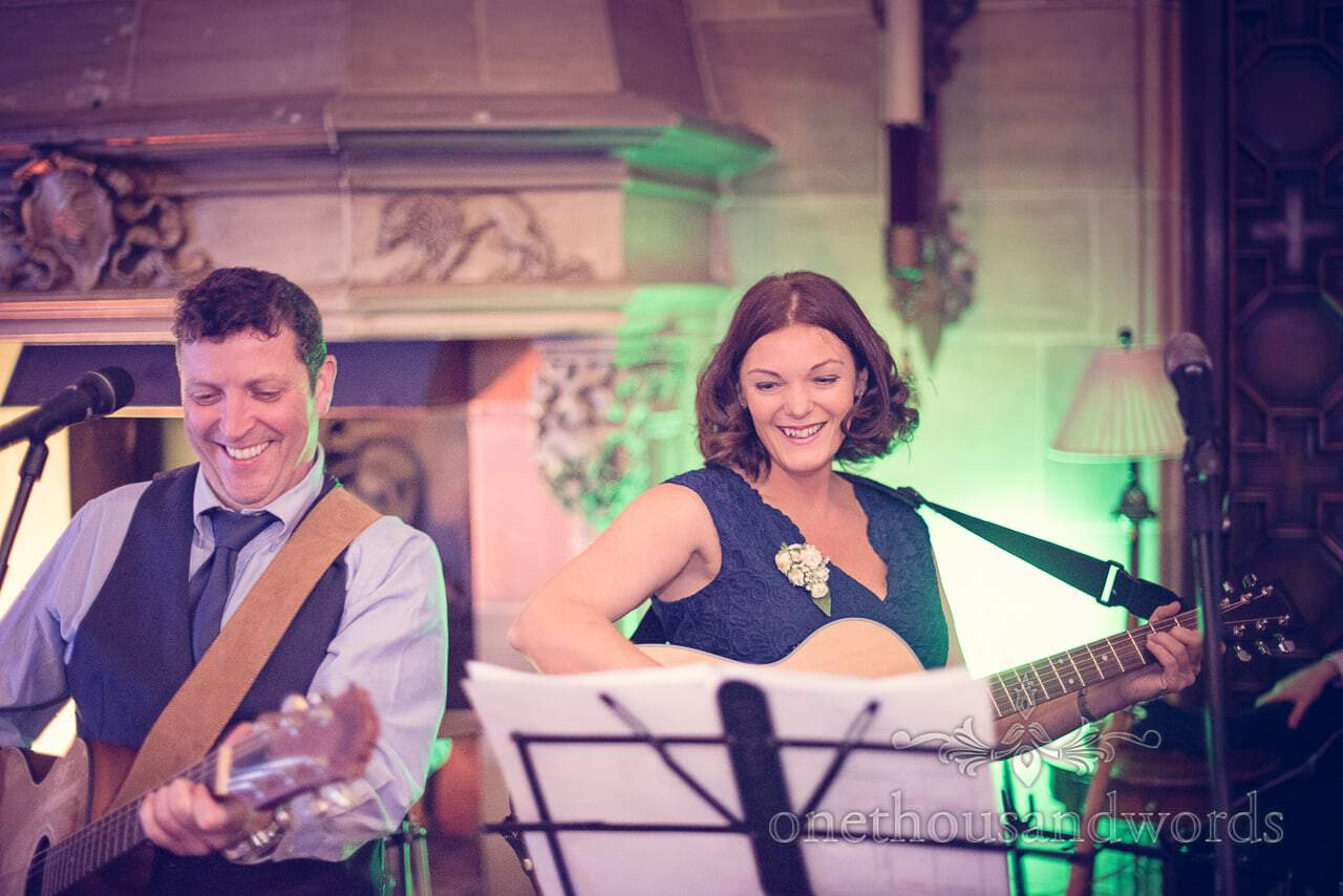 Mother of the bride plays guitar with wedding band at Northcote House wedding