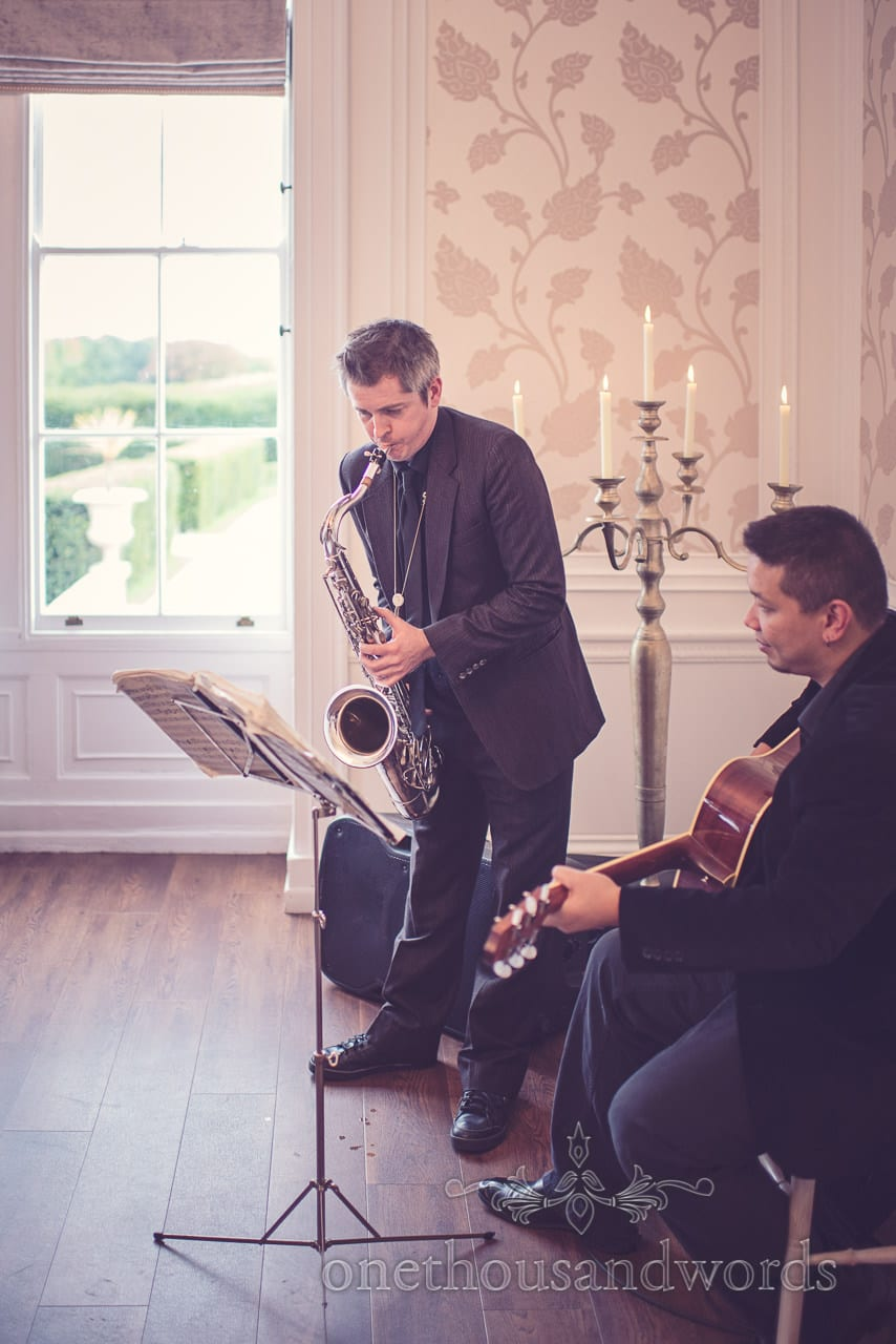 Musicians play during drinks reception at Froyle Park wedding photographs