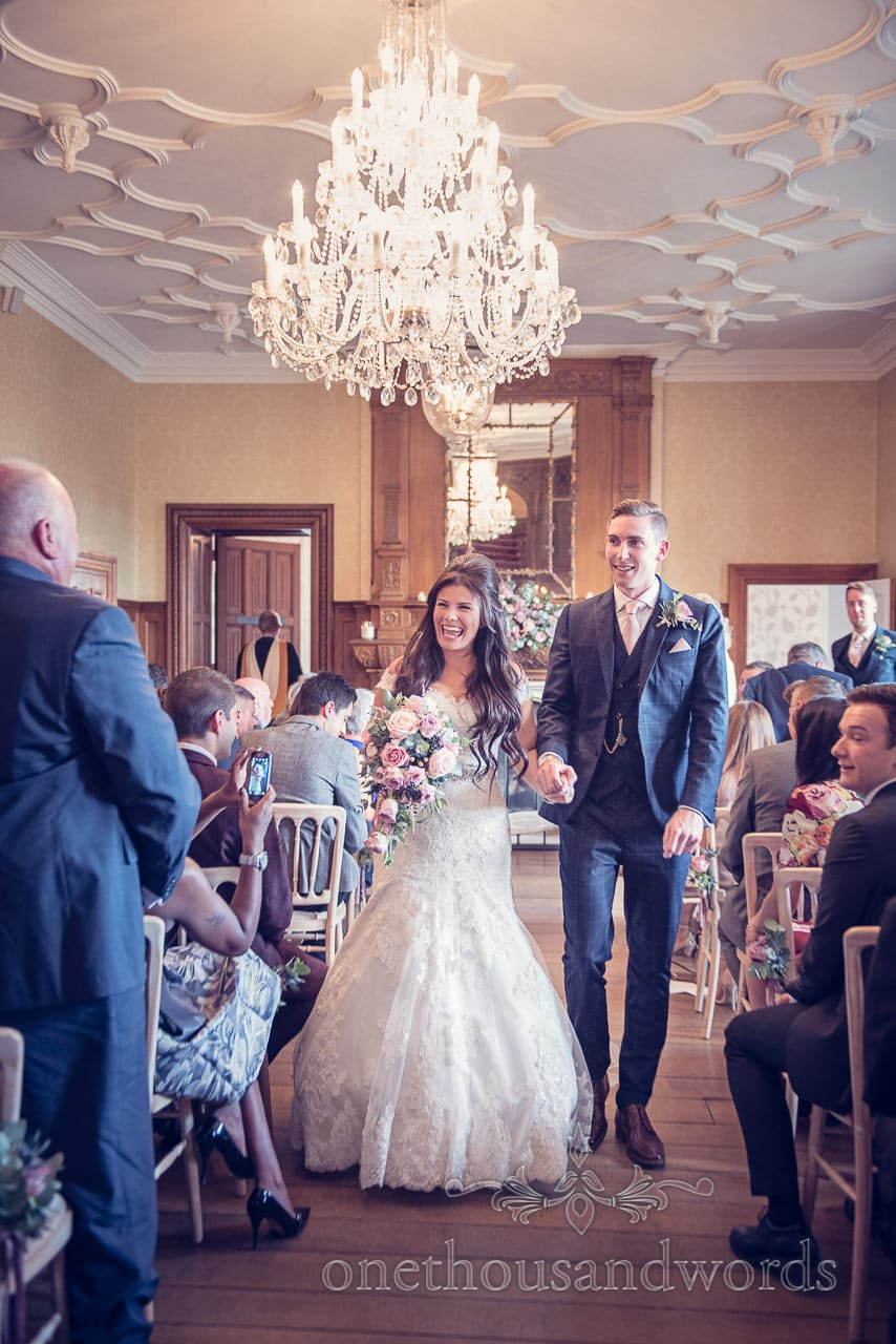 New Mr and Mrs walk down the aisle at Froyle Park wedding photographs