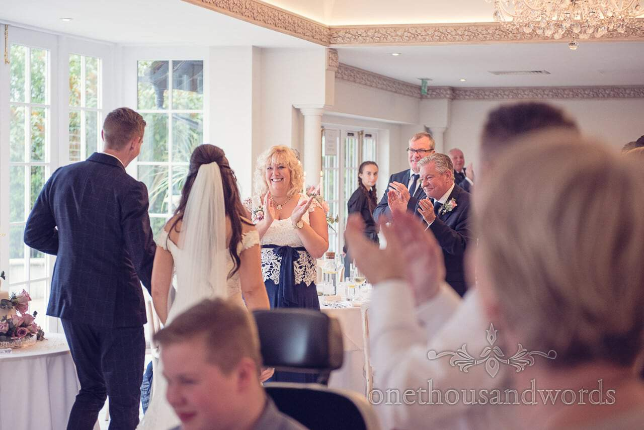 Newlyweds are welcomed into the room at Froyle Park wedding photographs