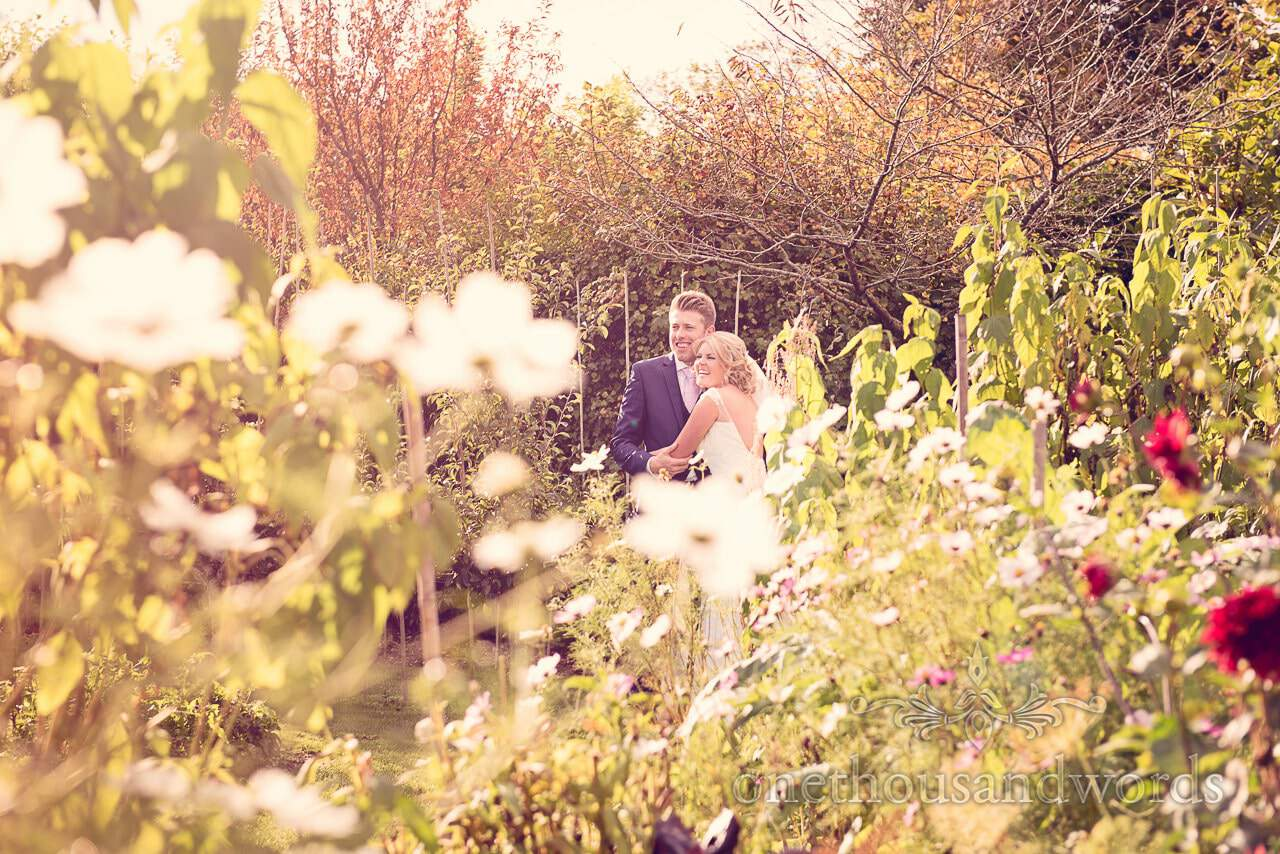 Newlyweds in garden at Holme for Gardens Dorset wedding
