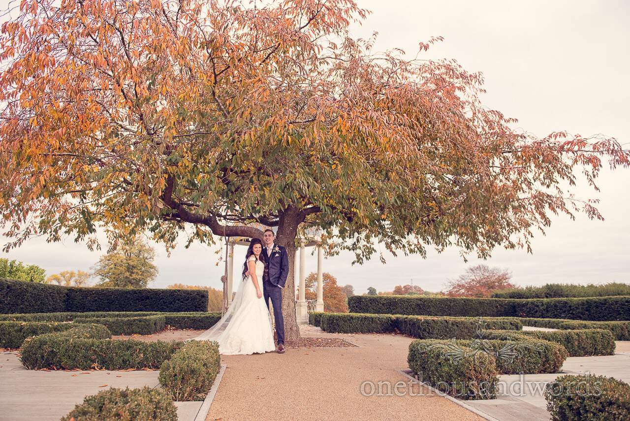 Newlyweds under tree at Froyle Park wedding photographs