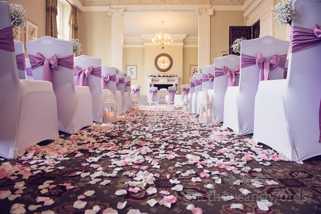 Northcote House Wedding Photographs Ceremony Room with petals
