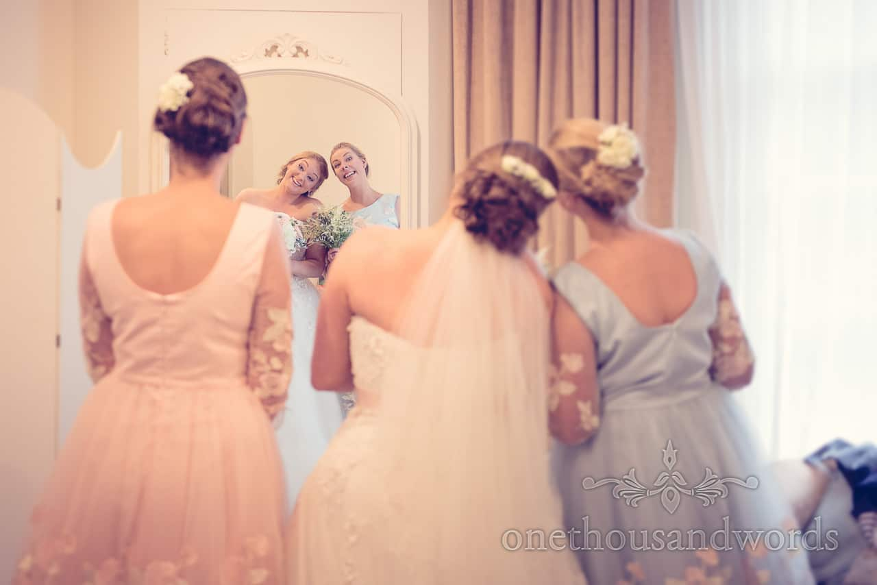 Northcote House wedding photographs of bride and bridesmaids smiling in mirror