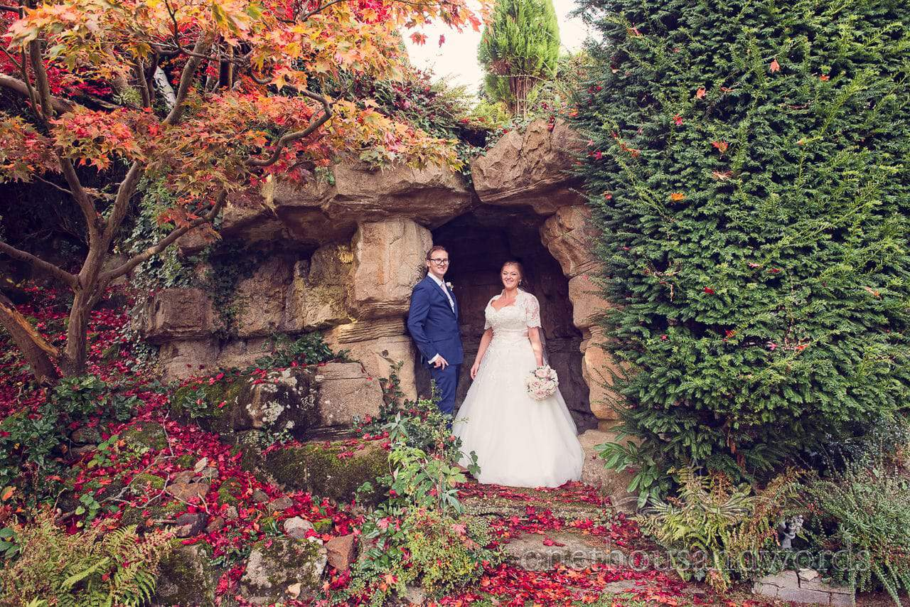 Northcote House wedding photographs of bride and groom in cave
