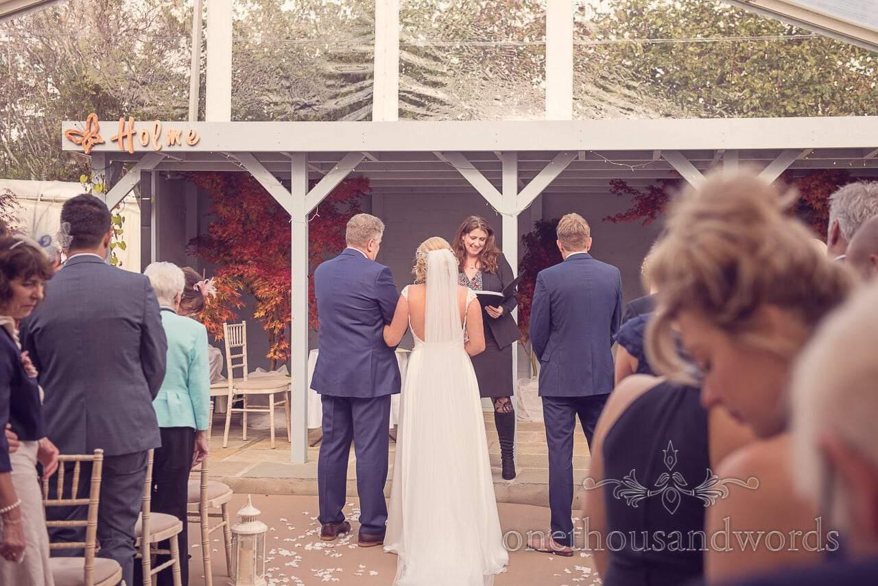 Registrar reads at Civil ceremony at Holme for Gardens Dorset wedding