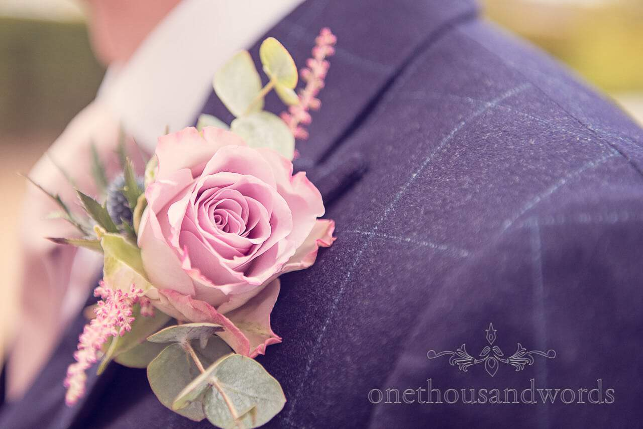 Soft pink rose wedding button hole flower at Froyle Park wedding