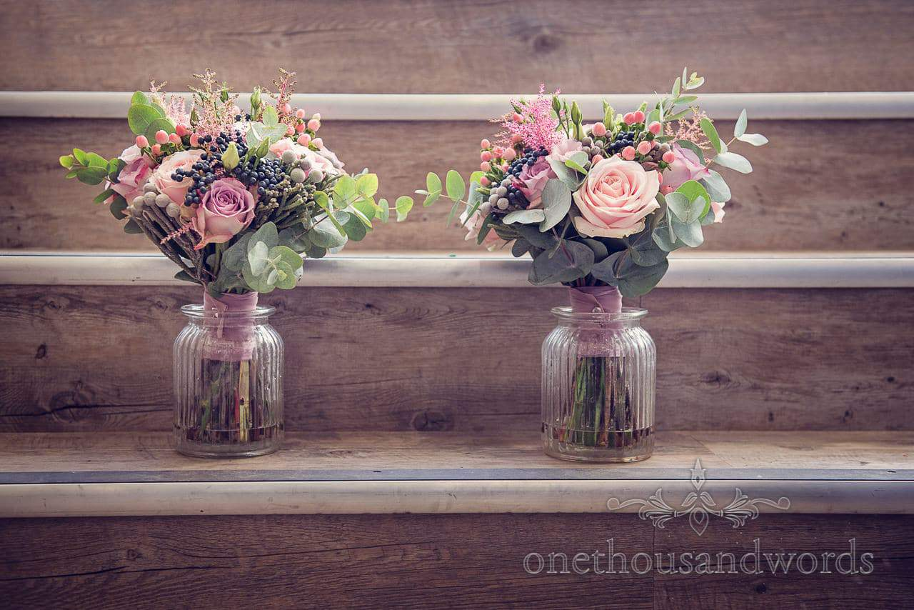 Soft pink wedding flower bouquets in jars by beyond the gate florist