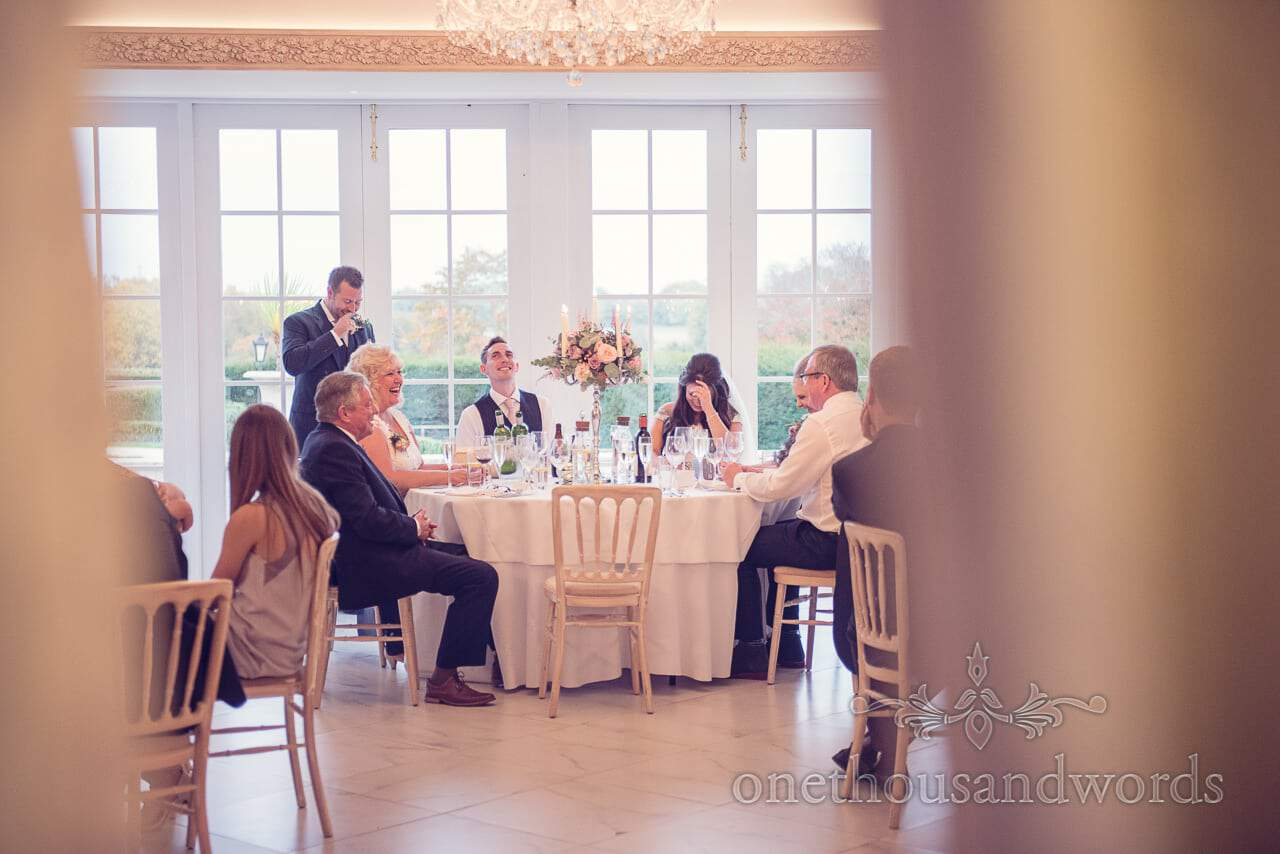 Top table during best mans speech at Froyle Park wedding photographs