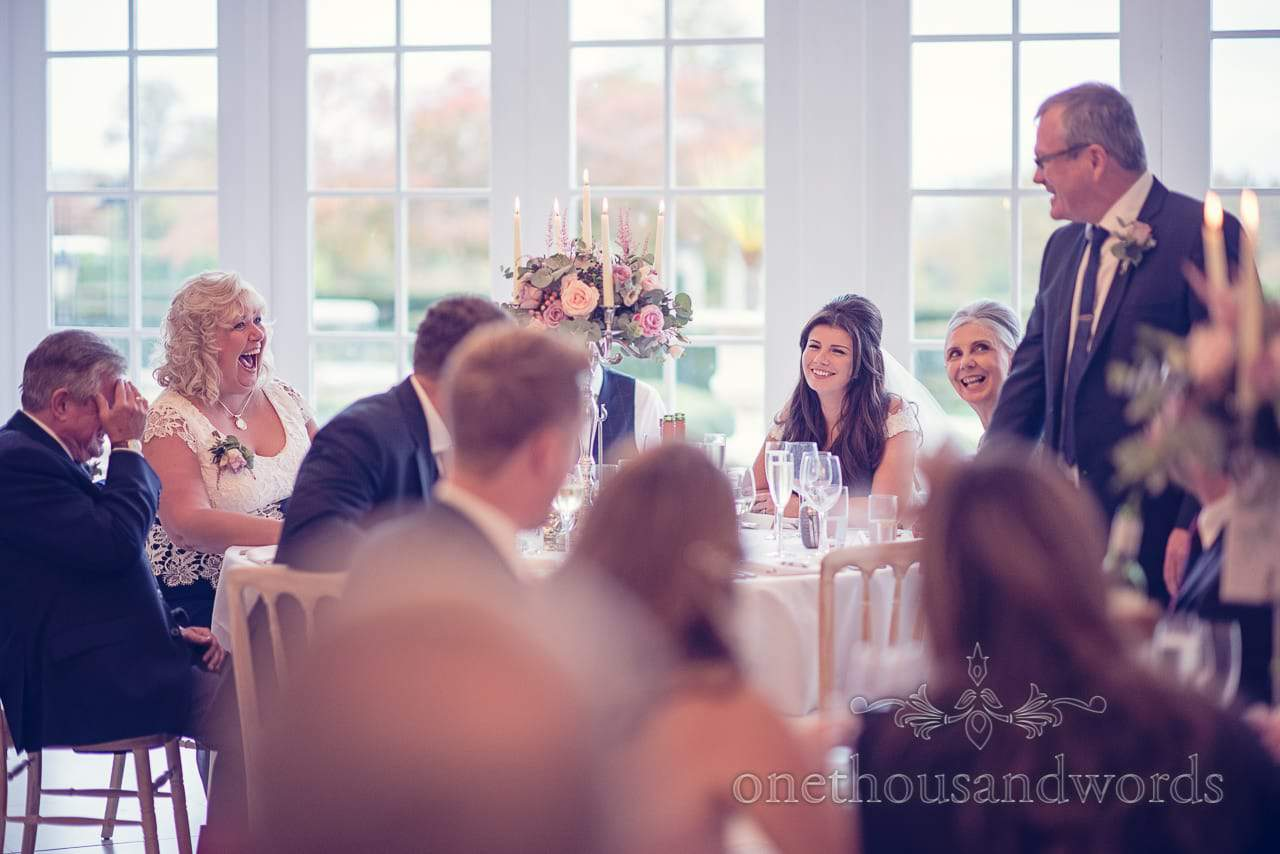 Top table reaction to Father of the bride speech at Froyle Park wedding photographs