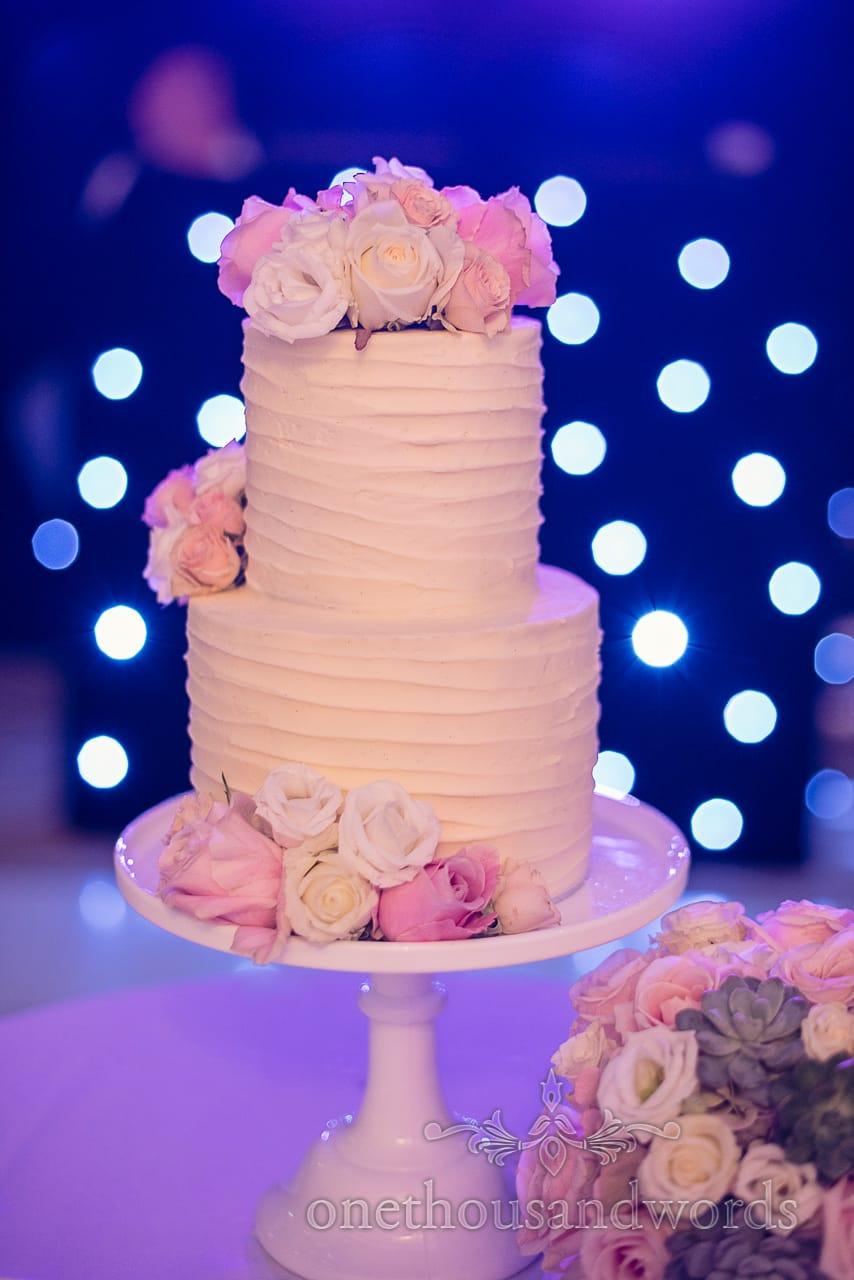 Wedding cake with flower decoration at Holme for Gardens Dorset wedding