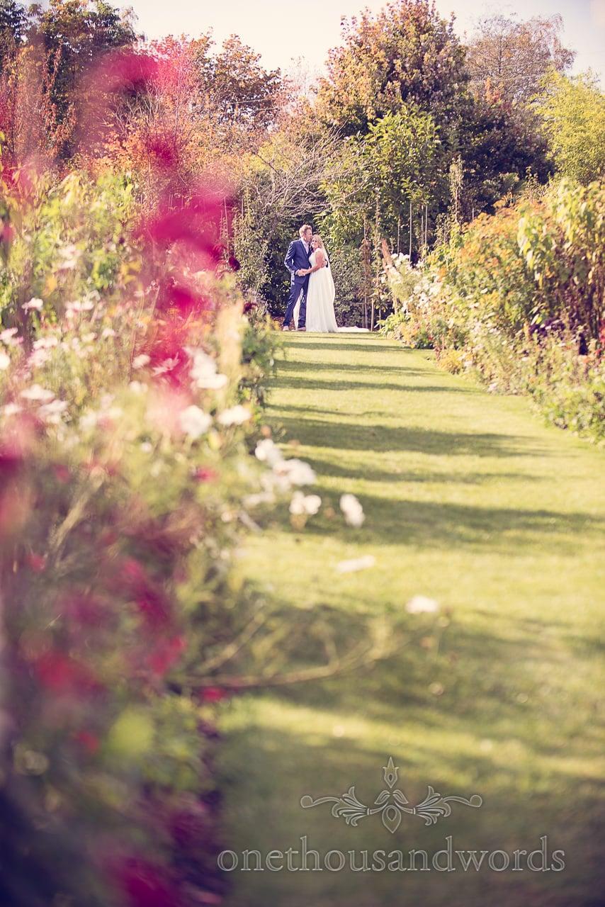 Wedding couple in garden at Holme for Gardens Dorset wedding