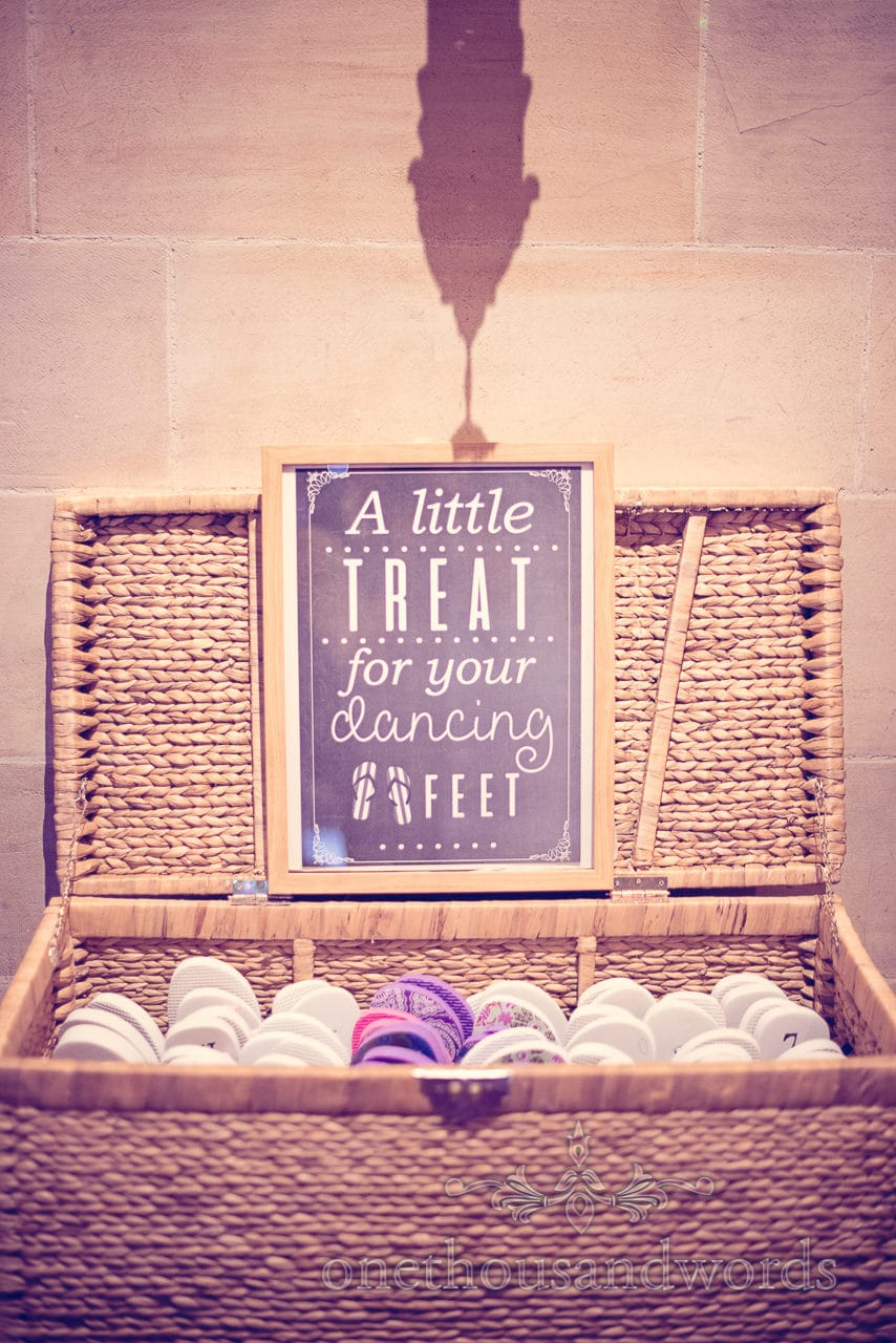 Wedding flip flops basket with a little treat for your dancing feet sign